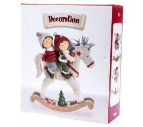Chlapec a dievča na húpacom koníkovi
